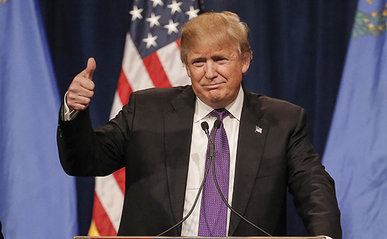 Republican U.S. presidential candidate Donald Trump gives a thumbs up as he addresses supporters after being declared by the television networks as the winner in the Nevada Repulican caucuses at his caucus night rally in Las Vegas